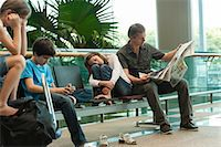 Family waiting in airport terminal Stock Photo - Premium Royalty-Freenull, Code: 632-06029734