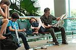 Family waiting in airport terminal Stock Photo - Premium Royalty-Free, Artist: IIC, Code: 632-06029734