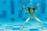 Girl swimming underwater in swimming pool Stock Photo - Premium Royalty-Freenull, Code: 632-06029785