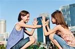 Girls playing pattycake
