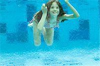 Girl swimming underwater in swimming pool Stock Photo - Premium Royalty-Freenull, Code: 632-06030188