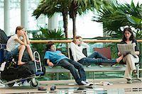 Family waiting in airport terminal Stock Photo - Premium Royalty-Freenull, Code: 632-06030238