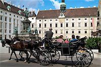 Horse-drawn carriage at the Hofburg, Vienna, Austria, Europe Stock Photo - Premium Rights-Managednull, Code: 841-06030478