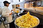 Chips being fried in traditional British chip shop, Gloucester, Gloucestershire, England, United Kingdom, Europe Stock Photo - Premium Rights-Managed, Artist: Robert Harding Images, Code: 841-06030798