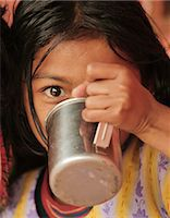 Young girl drinking from metal cup, Pokhara, Nepal, Asia Stock Photo - Premium Rights-Managednull, Code: 841-06030828