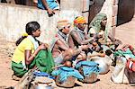 Bonda tribeswomen wearing traditional beaded caps and metal necklaces, selling village-made alcohol at weekly market, Rayagader, Orissa, India, Asia Stock Photo - Premium Rights-Managed, Artist: Robert Harding Images, Code: 841-06031736