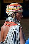 Bonda tribeswoman wearing grey blue cotton shawl and beads with beaded cap, large earrings and metal necklaces at weekly market, Rayagader, Orissa, India, Asia Stock Photo - Premium Rights-Managed, Artist: Robert Harding Images, Code: 841-06031739