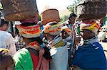 Bonda tribeswomen wearing traditional beaded caps and metal necklaces, with baskets on their heads at weekly market, Rayagader, Orissa, India, Asia Stock Photo - Premium Rights-Managed, Artist: Robert Harding Images, Code: 841-06031748