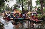 Brightly painted boats, Xochimilco, Trajinera, Floating Gardens, Canals, UNESCO World Heritage Site, Mexico City, Mexico, North America Stock Photo - Premium Rights-Managed, Artist: Robert Harding Images, Code: 841-06031817