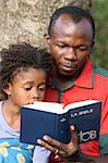 Father and daughter reading the Bible, Lome, Togo, West Africa, Africa Stock Photo - Premium Rights-Managed, Artist: Robert Harding Images, Code: 841-06032352