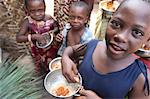 Children eating a meal, Lome, Togo, West Africa, Africa Stock Photo - Premium Rights-Managed, Artist: Robert Harding Images, Code: 841-06032402