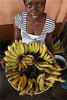Girl selling bananas, Lome, Togo, West Africa, Africa Stock Photo - Premium Rights-Managednull, Code: 841-06032409