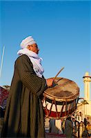 Drummer at Tahtib demonstration, a traditional form of Egyptian folk dance involving a wooden stick, also known as stick dance or cane dance, Mosque of Abu el-Haggag, Luxor, Egypt, North Africa, Africa Stock Photo - Premium Rights-Managednull, Code: 841-06032866