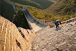 Chinese man climbs Great Wall of China, UNESCO World Heritage Site, Huanghuacheng (Yellow Flower) at sunset in autumn, Jiuduhe Zhen, Huairou, China, Asia Stock Photo - Premium Rights-Managed, Artist: Robert Harding Images, Code: 841-06033073