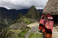 peru and culture - Traditionally dressed children looking over the ruins of the Inca city of Machu Picchu, UNESCO World Heritage Site, Vilcabamba Mountains, Peru, South America Stock Photo - Premium Rights-Managednull, Code: 841-06034484