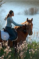 Woman riding horse in rural field Stock Photo - Premium Royalty-Freenull, Code: 649-06040034