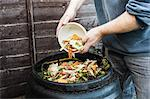 Man adding to compost bin outdoors Stock Photo - Premium Royalty-Free, Artist: ableimages, Code: 649-06040084