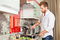 stove - Man cooking in kitchen Stock Photo - Premium Royalty-Freenull, Code: 649-06040113