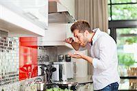 stove - Man tasting food in kitchen Stock Photo - Premium Royalty-Freenull, Code: 649-06040114