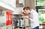 Man tasting food in kitchen Stock Photo - Premium Royalty-Free, Artist: Jodi Pudge, Code: 649-06040114