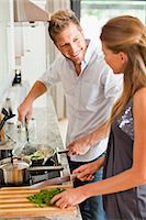 stove - Couple cooking together in kitchen Stock Photo - Premium Royalty-Freenull, Code: 649-06040118