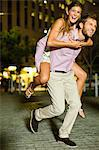 Man carrying girlfriend on city street Stock Photo - Premium Royalty-Free, Artist: Allan Baxter, Code: 649-06040169