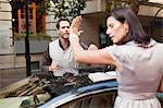 Couple arguing over sports car Stock Photo - Premium Royalty-Free, Artist: CulturaRM, Code: 649-06040247