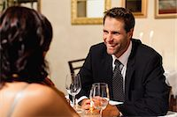 Couple having dinner in restaurant Stock Photo - Premium Royalty-Freenull, Code: 649-06040270