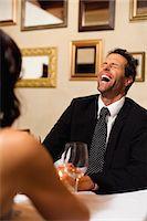 Couple having dinner in restaurant Stock Photo - Premium Royalty-Freenull, Code: 649-06040271