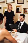 Couple ordering dinner in restaurant Stock Photo - Premium Royalty-Free, Artist: Blend Images, Code: 649-06040277