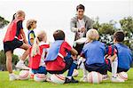Coach talking to childrens soccer team Stock Photo - Premium Royalty-Freenull, Code: 649-06040301
