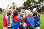Children raising hands during practice Stock Photo - Premium Royalty-Freenull, Code: 649-06040307
