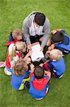 Coach talking to childrens soccer team Stock Photo - Premium Royalty-Freenull, Code: 649-06040309