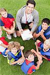 Coach talking to childrens soccer team Stock Photo - Premium Royalty-Free, Artist: Kevin Dodge, Code: 649-06040310