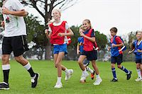football team - Coach training children on field Stock Photo - Premium Royalty-Freenull, Code: 649-06040319