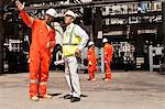 Workers talking at oil refinery Stock Photo - Premium Royalty-Free, Artist: Marc Simon, Code: 649-06040355