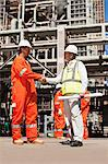 Workers shaking hands at oil refinery Stock Photo - Premium Royalty-Free, Artist: Marc Simon, Code: 649-06040357