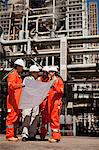 Workers with blueprints at oil refinery Stock Photo - Premium Royalty-Free, Artist: Marc Simon, Code: 649-06040360