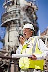 Worker with walkie talkie on site Stock Photo - Premium Royalty-Free, Artist: Marc Simon, Code: 649-06040367
