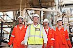 Workers walking at oil refinery Stock Photo - Premium Royalty-Free, Artist: Marc Simon, Code: 649-06040384