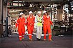 Workers walking at oil refinery Stock Photo - Premium Royalty-Free, Artist: Marc Simon, Code: 649-06040394
