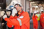 Worker with walkie talkie on site Stock Photo - Premium Royalty-Free, Artist: Cultura RM, Code: 649-06040399