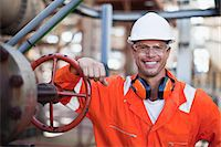 refinery - Worker smiling at oil refinery Stock Photo - Premium Royalty-Freenull, Code: 649-06040404