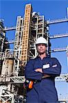 Worker standing at oil refinery Stock Photo - Premium Royalty-Free, Artist: Marc Simon, Code: 649-06040408