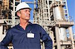 Worker standing at oil refinery Stock Photo - Premium Royalty-Free, Artist: Cultura RM, Code: 649-06040411