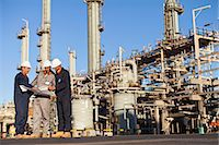 refinery - Workers with blueprints at oil refinery Stock Photo - Premium Royalty-Freenull, Code: 649-06040417