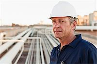 pipe (industry) - Close up of worker at oil refinery Stock Photo - Premium Royalty-Freenull, Code: 649-06040421