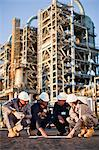 Workers with blueprints at oil refinery Stock Photo - Premium Royalty-Free, Artist: Marc Simon, Code: 649-06040424