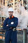 Worker standing at oil refinery Stock Photo - Premium Royalty-Free, Artist: Cultura RM, Code: 649-06040429