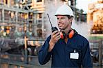Worker using walkie talkie on site Stock Photo - Premium Royalty-Free, Artist: Marc Simon, Code: 649-06040430